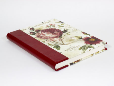 Blank handmade book bound in quarter leather with printed paper with roses