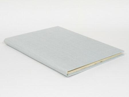 Llibreta feta a mà en lli blau