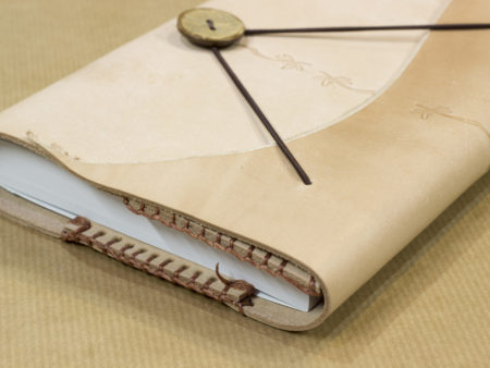 Book with interchangeable interior and leather cover