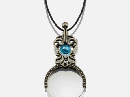 Vista de la lupa con la perla de cristal de Murano